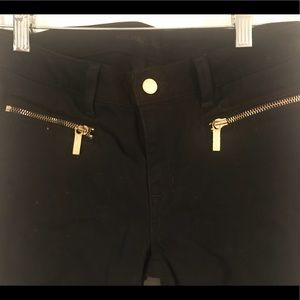 Black Michael Kors jeans with gold details
